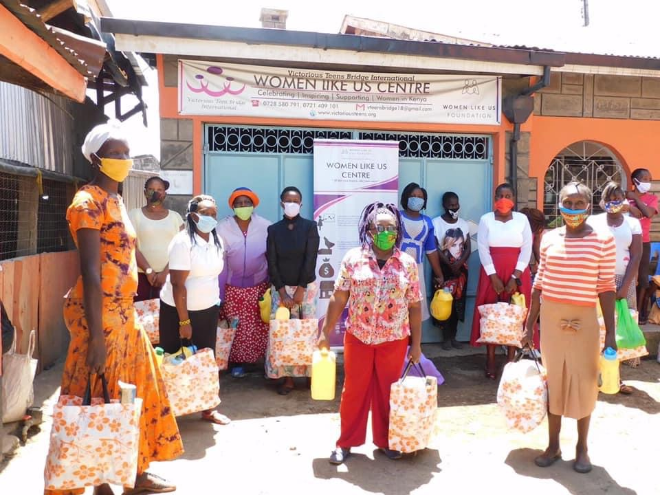 Image of women in Nakuru Kenya holding grocery store bag donations