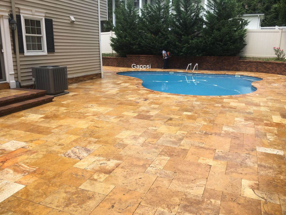 Travertine pool coping and patio sealed by Gappsi