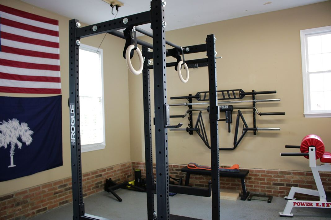 A spacious garage gym we like the matador dip bar work out