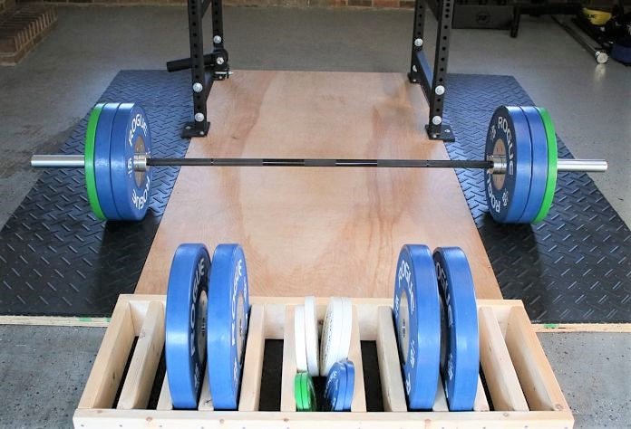 Rogue Ohio Power Bar with Rogue Competition Bumpers in Garage Gym