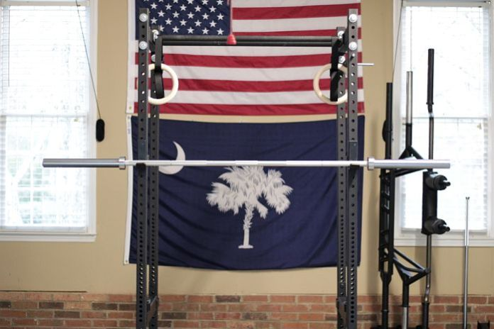 Fringe Sport Power Bar on Power Rack in Garage Gym