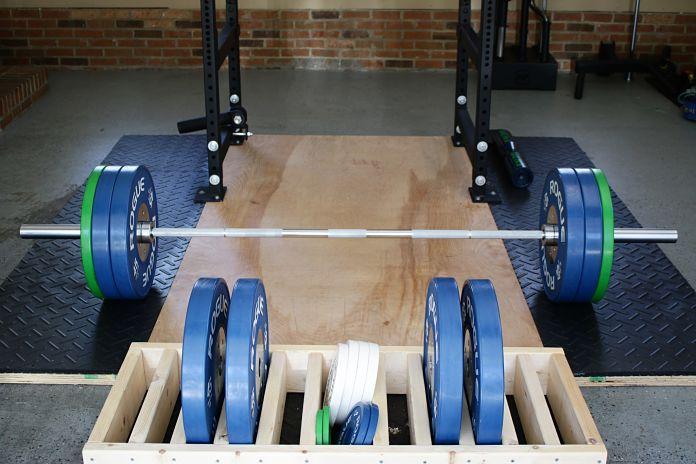 Rogue kb calibrated weight plate for olympic barbell garage