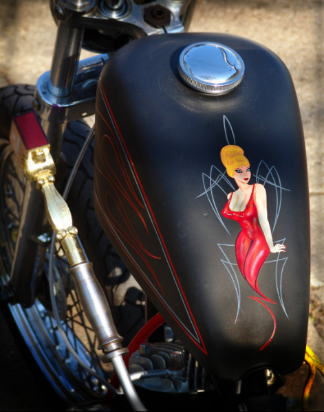 A 3 breasted 1960's Pin up! What eles could you put on a 3 wheeled trike with a name like Menage A Trois? If ones good, then two is better and three is just right!