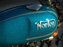 On this project we decided to keep the factory original and rare, blue metal flake paint. After restoring the base color, we added a custom touch with hand lettered and spun silver leaf Norton logo, along with a bit of hand pin striping.