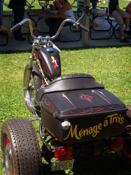 """An overview of the """"3"""" themed Harley Flathead trike. Ivory and red pinstriping over satin black, 23K gold leaf lettering."""