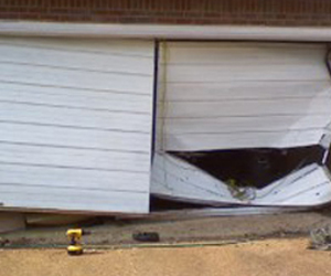 Broken Garage Door - Save money buying a new one