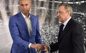 Real Madrid's new French coach Zinedine Zidane (L) is congratulated by Real Madrid's president Florentino Perez after a statement at the Santiago Bernabeu stadium in Madrid on January 4, 2016. Rafael Benitez's unhappy reign in charge of Real Madrid came to an end after just seven months and 25 games when he was sacked and replaced by club legend Zinedine Zidane today.   AFP PHOTO/ GERARD JULIENGERARD JULIEN/AFP/Getty Images