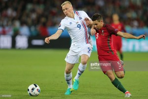Kolbeinn Sigthorsson (ISL), Raphael Guerreiro (POR), during the UEFA EURO 2016 Group F match between Portugal and Iceland at Stade Geoffroy-Guichard on June 14, 2016 in Saint-Etienne, France. (Photo by Foto Olimpik/NurPhoto)