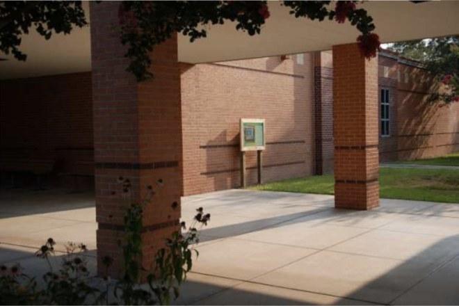 School garden sign installation.