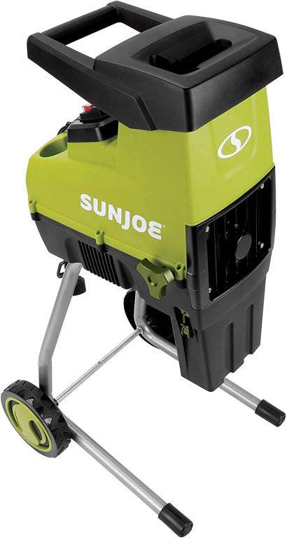 A green and grey two-tone electric wood chipper with metal legs and black wheels with a black hopper on top.