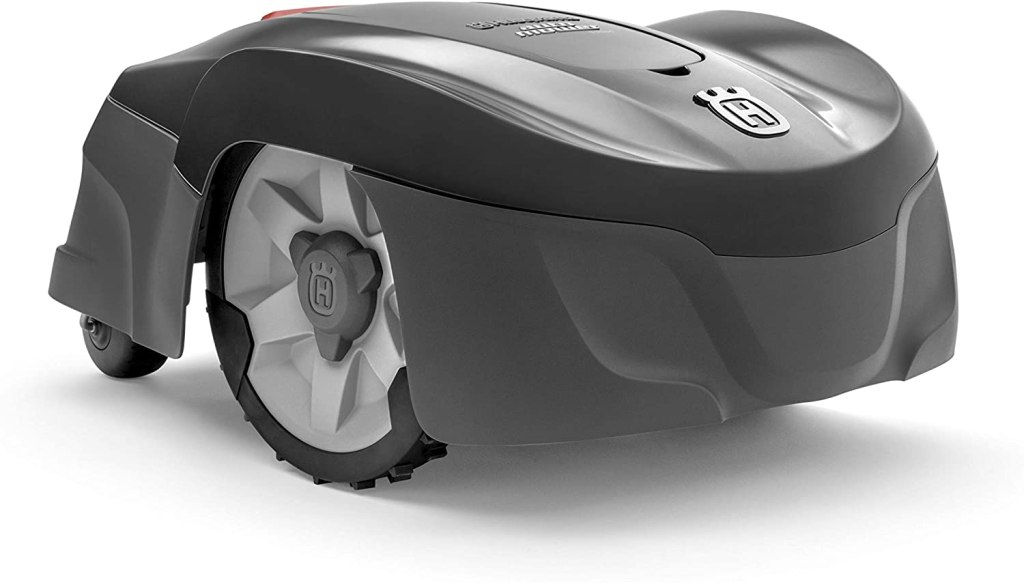 The two-tone glossy gray and light gray husqvarna robotic mower with black and white wheels.