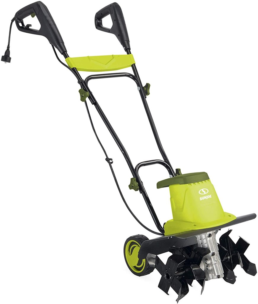 A bright green and glossy black electric tiller with four black tines, a power cord, and dual handles with extra-large pistol grips.