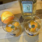 two tequila old fashioneds on a wooden board