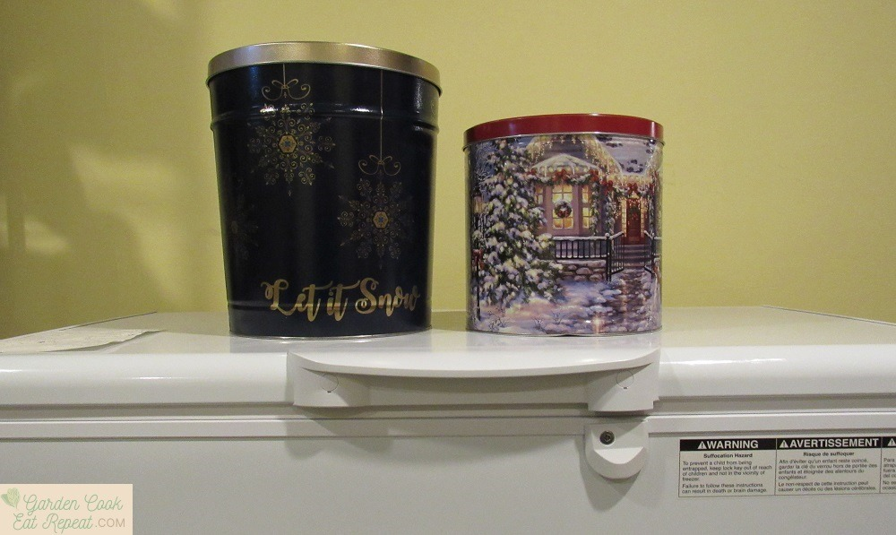 Holiday popcorn tins make great storage containers