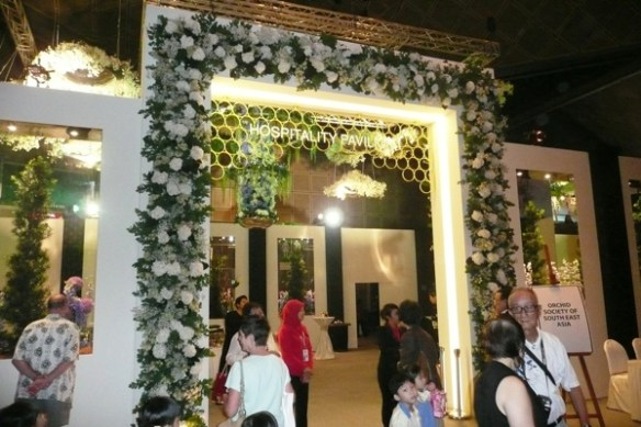 One of the hospitality pavilions adorned with white floral arrangements