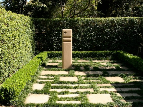 Mini mondo used to accentuate paving design. Design Jim Roustas Glorious Gardens