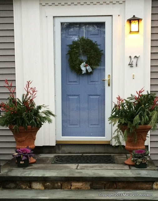 A colorful welcome outside my front door. The pots of ornamental kale add a note of color