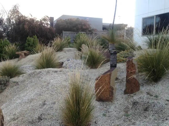 Looking across the front garden. Beach house Toquay. Design Phillip Withers