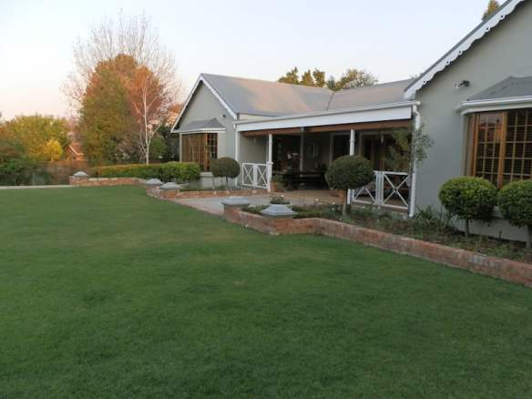 Lawn and new garden beds around the front entrance