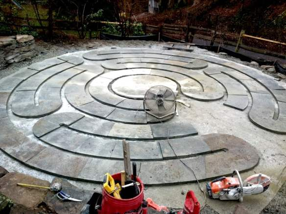 The cut labyrinth paving stones laid out