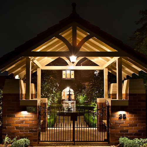 Night lighting lych gate. Design by Gardens at Night, Sydney