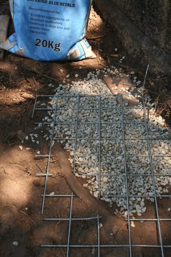 Spreading blue metal and positioning a cutout section around an important tree root