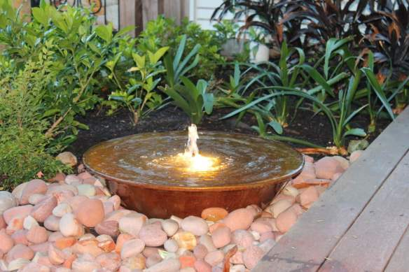 A water bowl with bubbler fountain introduces sound and light
