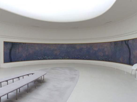 Within one of the two oval rooms that house Monet's waterlily series at Musée de l'Orangerie