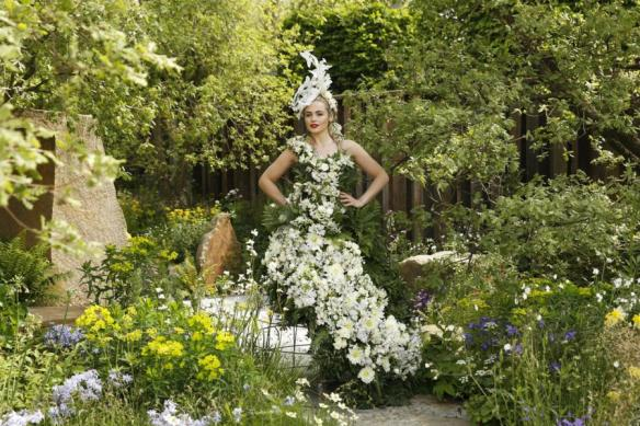 A model poses in a dress of flowers and foliage designed by Cleve West in the M&G garden at the RHS Chelsea Flower Show 2016 in London, UK Monday May 23, 2016. RHS / Luke MacGregor