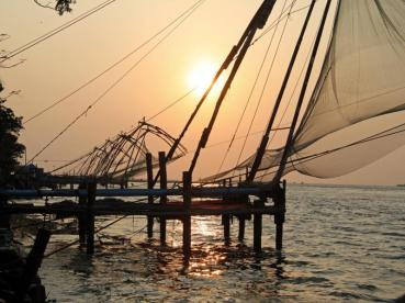 Chinese fishing nets at Fort Cochin and sunset over the Arabian Sea. Quite a combination.