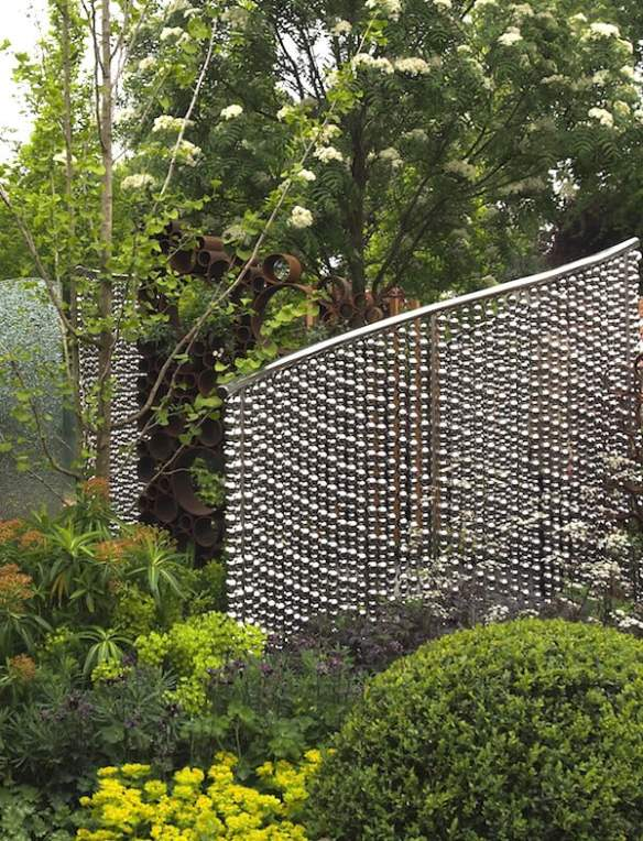 Stainless steel bead screen. SeeAbility garden, design Darren Hawkes Landscapes. Chelsea Flower Show 2013