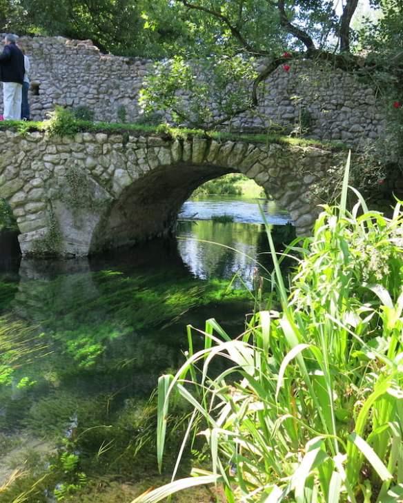 Bridge over crystal clear water at Ninfa. Photo Deryn Thorpe