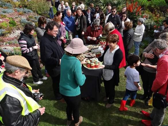 Cake and crowds in Attila Kapitany's garden