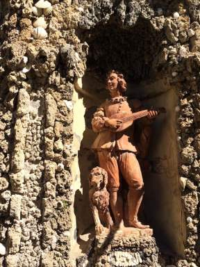 TERRACOTTA MINSTREL AND DOG IN CABINETTA