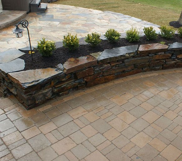 Unit paving, wall and stone flagging working well together -design and construction by Creative By Design, Calgary, Alberta, Canada
