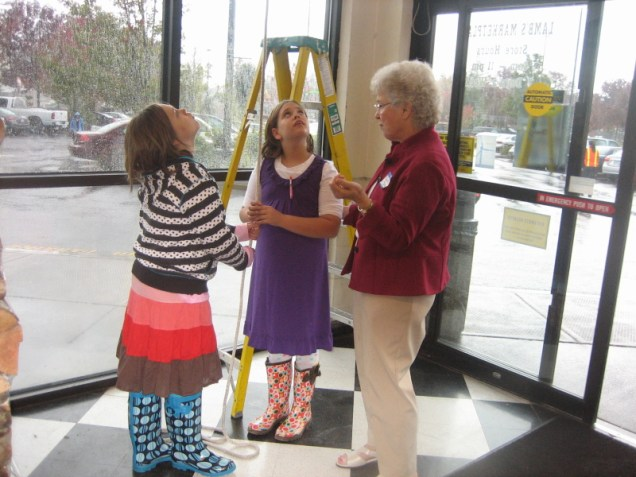 Elaine Shreve with bell ringers