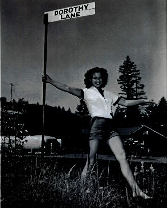 Dorothy waving at street sign (now SW 88th Ave)