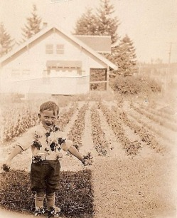 John Adams as a child with flowers pinned to his shirt