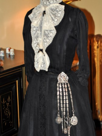 My favorite: a period dress with sewing accessories hung at the hip