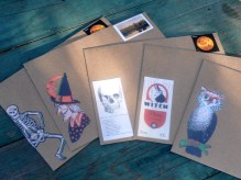 Decorating the envelopes with fun stamps and Tim Holtz ephemera