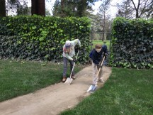 Mike and another volunteer shoveling silt