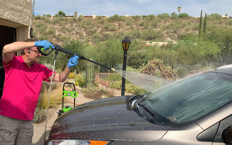 Greenworks-1800-PSI-Pressure-Washer-washing-car-with-40-degree-nozzle