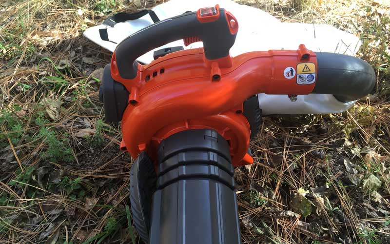 Husqvarna-mulch-vac-tube-attached-to-engine