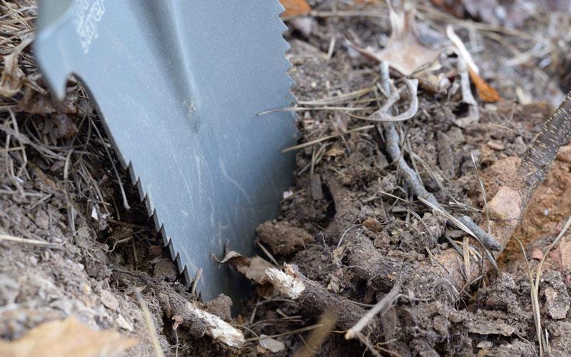 Radius Root Slayer Shovel slicing through roots