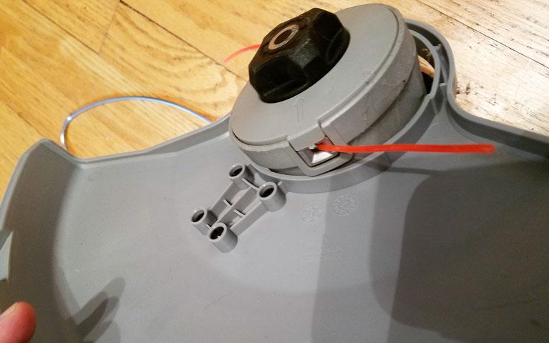 Redback-120v-String-Trimmer-attaching-trimmer-guard-base-7