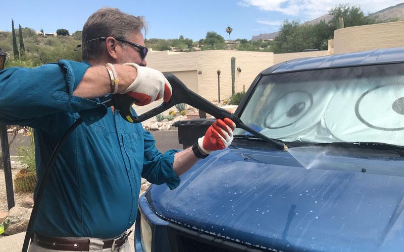 Sun-Joe-Cordless-Pressure-Washer-washing-car