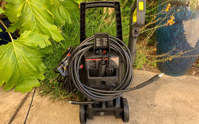 Sun-Joe-SPX1501-Pressure-Washer-holding-all-the-gear
