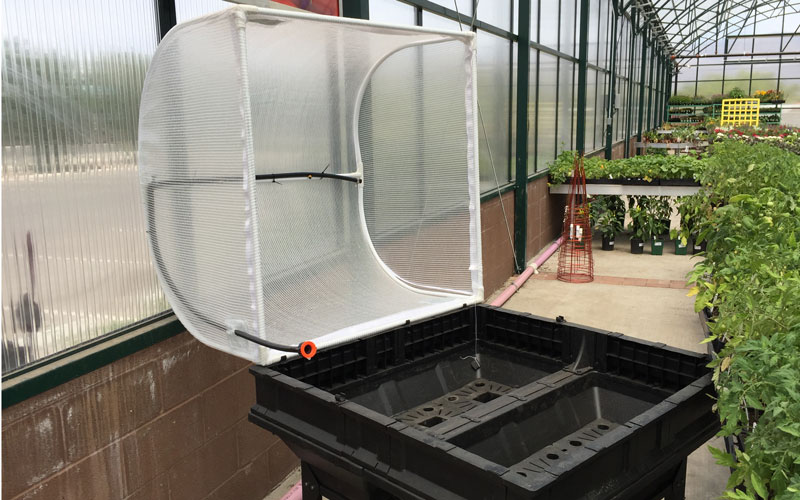Vegepod hinge clips holding greenhouse cover