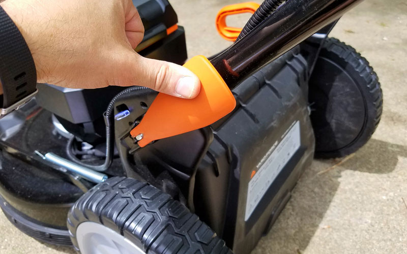 Yard Force 120V Cordless Mower securing fasteners on each side of the handle