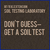 Brown sign with the words don't guess, get a soil test in tan letter